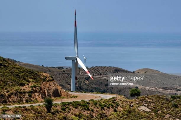 close up of windmills on the hills near the sea in aegean turkey. - emreturanphoto fotografías e imágenes de stock