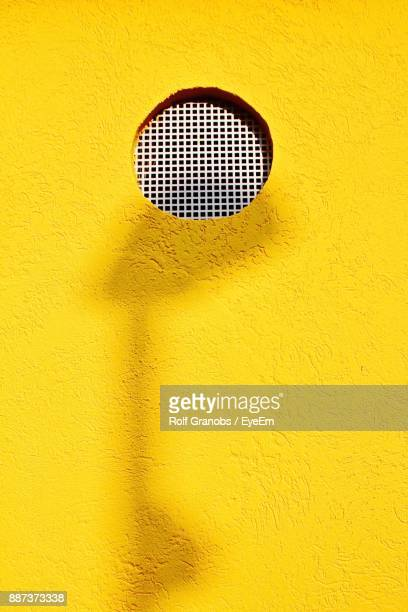 Close Up Of Window On Yellow Wall
