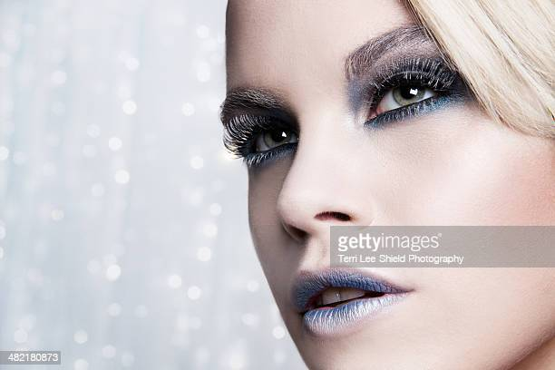 Close up of woman against glittery background