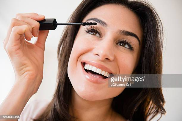 Close up of woman applying makeup