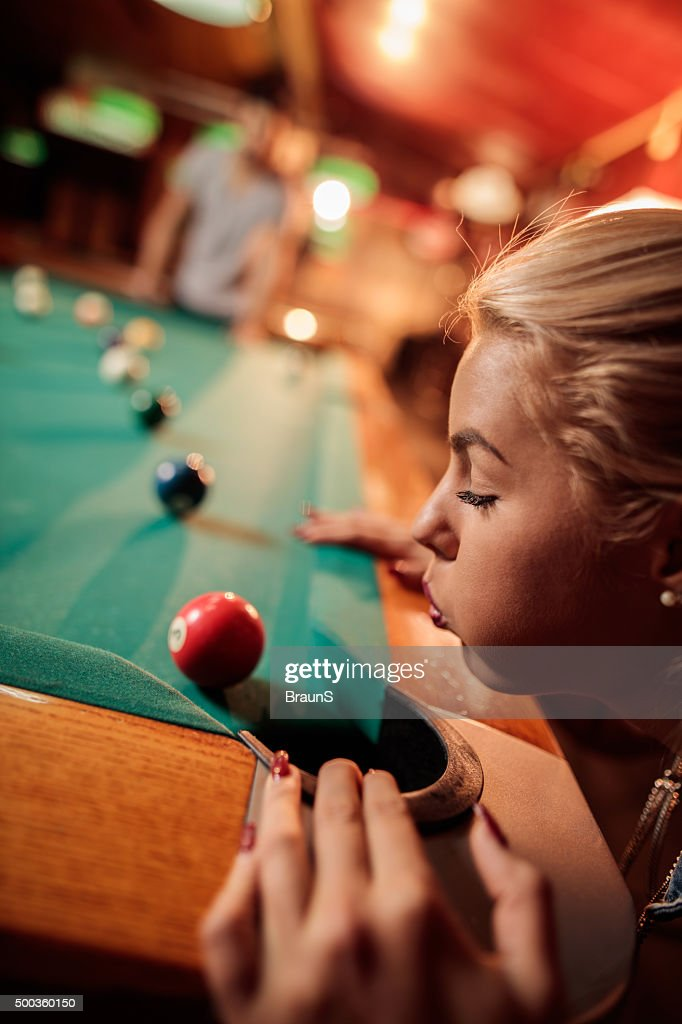Close Up Of Woman Blowing Pool Ball Away From Hole Stock Photo ... 5ba94fa2b7