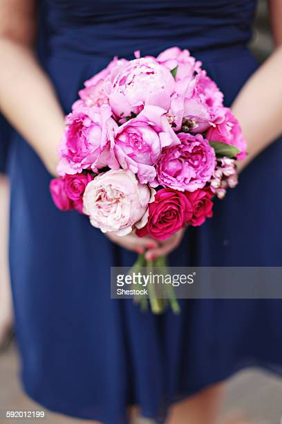 Close up of woman carrying bouquet of flowers