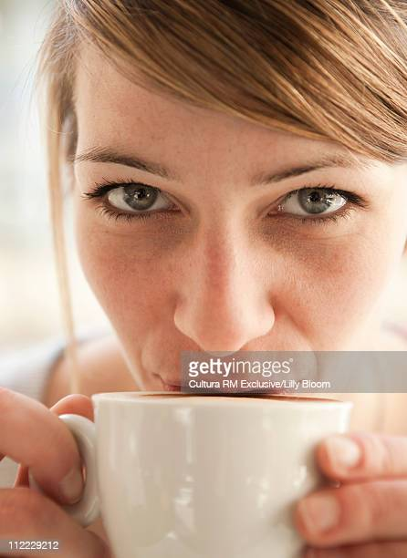Close up of woman drinking cappucino