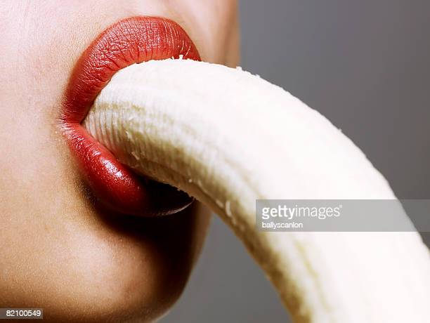 close up of woman eating banana - sucking stock photos and pictures