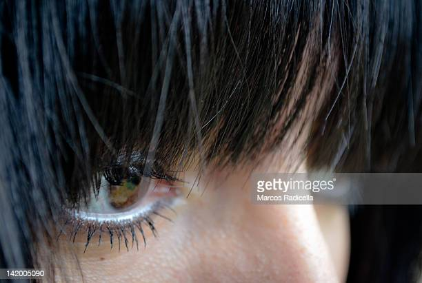 close up of woman eyes - radicella stock pictures, royalty-free photos & images