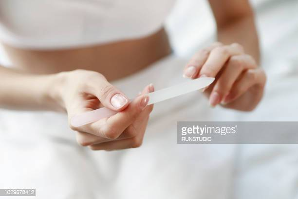 close up of woman filing nails - les belles japonaises photos et images de collection