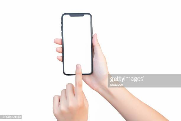 close up of woman hand holding smartphone on white background, cropped hand using smartphone on the background - menschlicher finger stock-fotos und bilder
