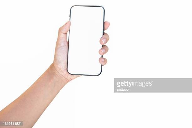 close up of woman hand holding smartphone on white background, cropped hand using smartphone on the background white - reaching stock pictures, royalty-free photos & images