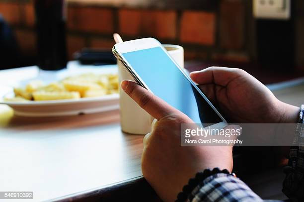 Close up of woman hands holding a smart phone