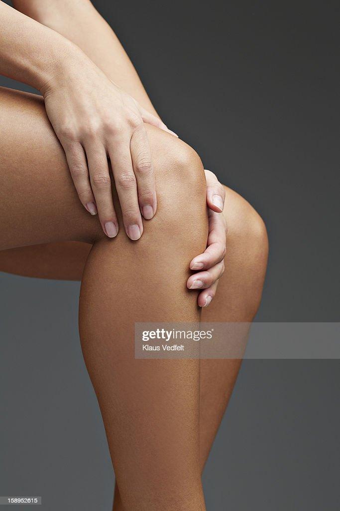 Close up of woman having knee pain : Stock Photo