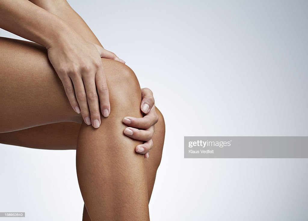 Close up of woman having knee pain : Stock Photo