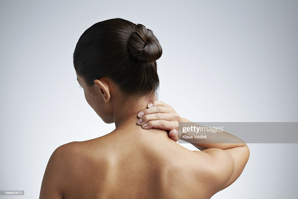 Close up of woman having neck pain : Stock-Foto