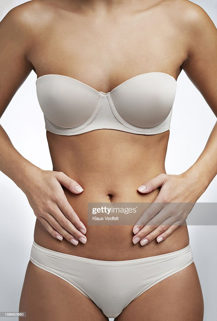 Close up of woman having stomach pain : Stock-Foto