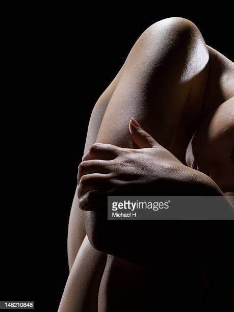 Close up of woman holding her elbow