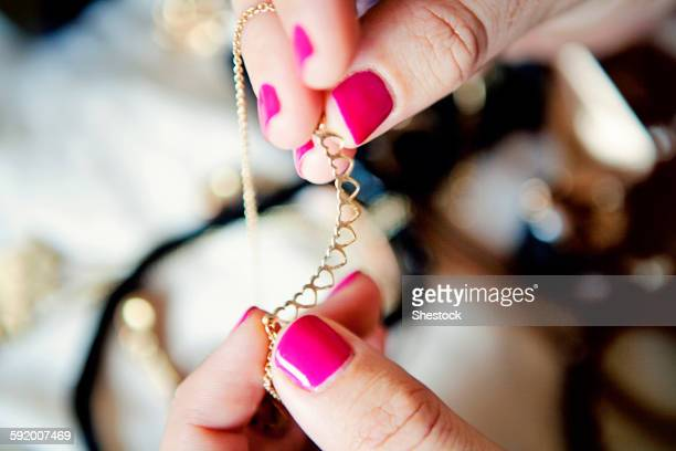 Close up of woman holding jewelry