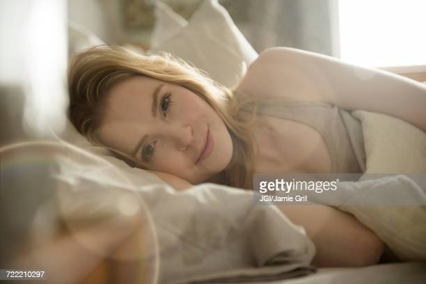 Close up of woman laying in bed