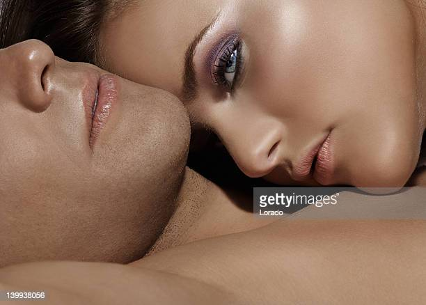 close up of woman laying on husband