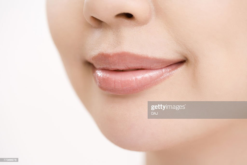 Close up of woman lips, side view   : Photo