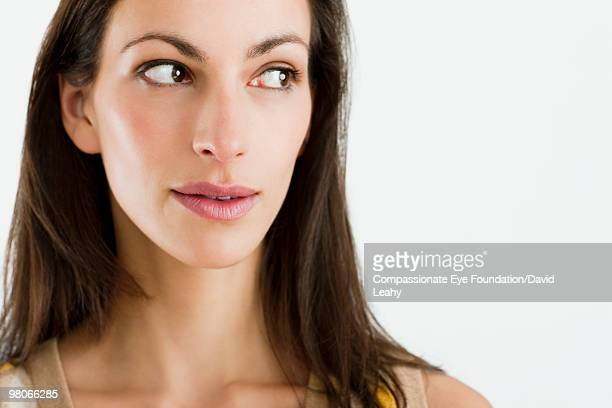 "close up of woman looking off to the side - ""compassionate eye"" - fotografias e filmes do acervo"