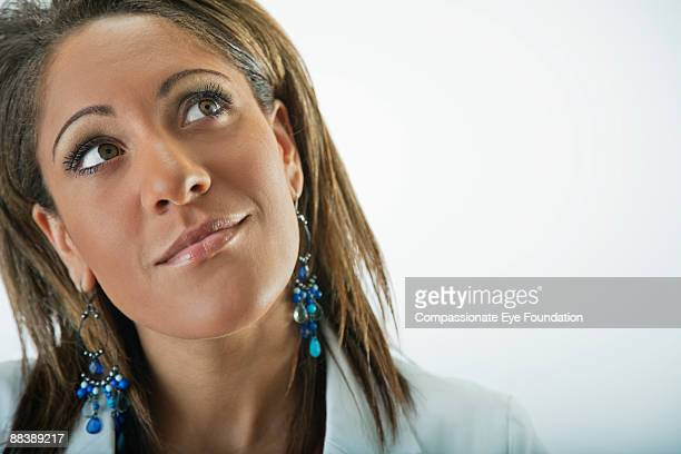 """close up of woman looking upwards - """"compassionate eye"""" stock pictures, royalty-free photos & images"""