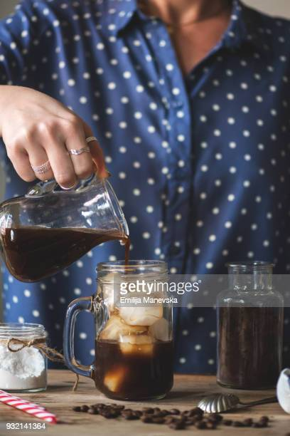 Close up of woman pouring coffee