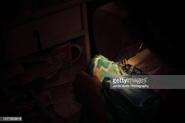 close up of woman sewing - fashion week stock pictures, royalty-free photos & images