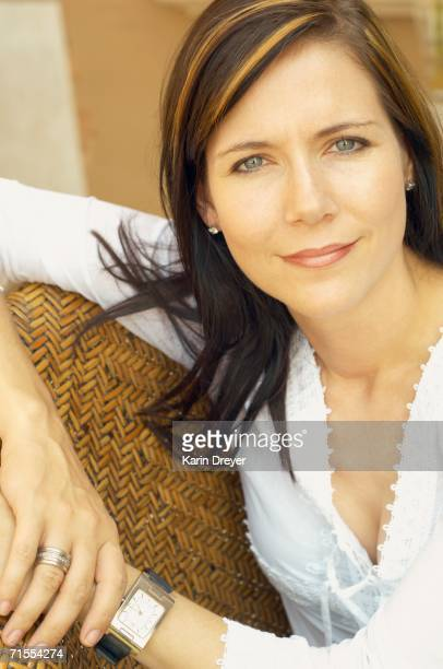 Close up of woman sitting in chair