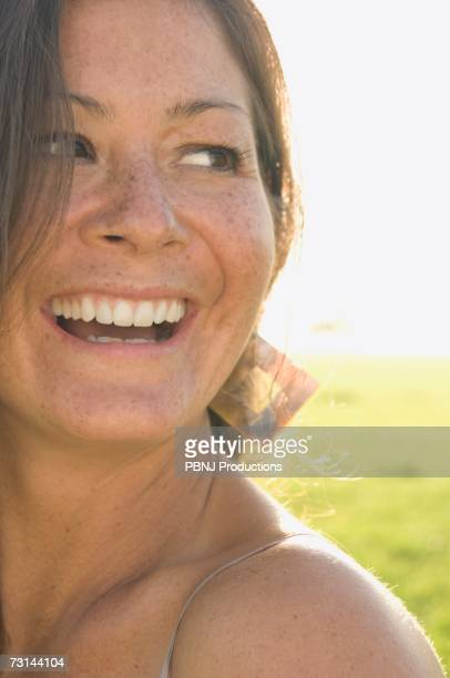 close up of woman smiling in sunlight outdoors - beautiful polynesian women stock photos and pictures