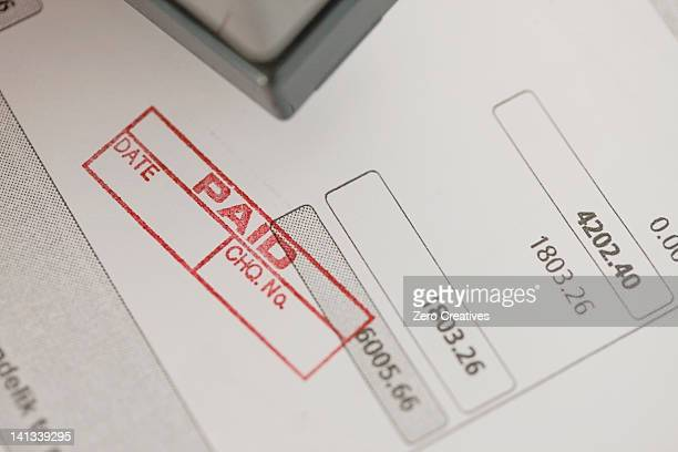 close up of woman stamping paid - paid stock pictures, royalty-free photos & images