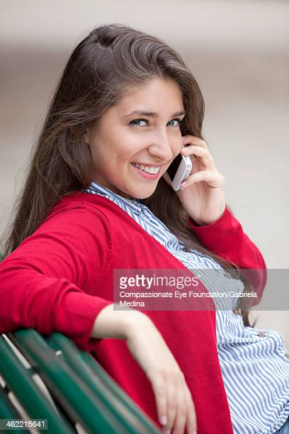 close up of woman using cell phone outdoors - cef do not delete stock pictures, royalty-free photos & images