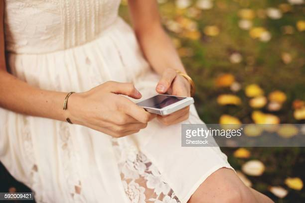 Close up of woman using cell phone outdoors