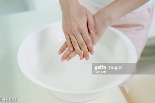 close up of woman washing hands in bowl - good condition stock pictures, royalty-free photos & images