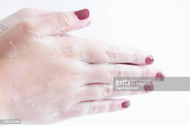 close up of woman washing her hands - sigrid gombert stockfoto's en -beelden