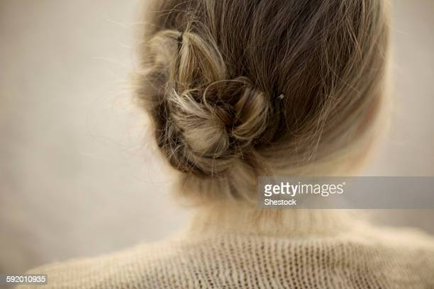 Close up of woman wearing bun and sweater