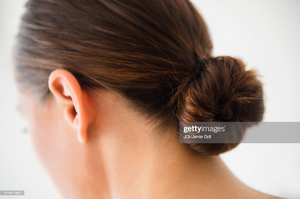 Close up of woman wearing bun in hair : Stock Photo