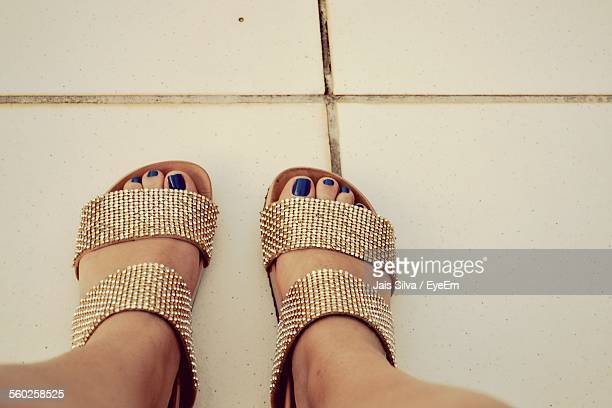Close Up Of Woman Wearing Sandals