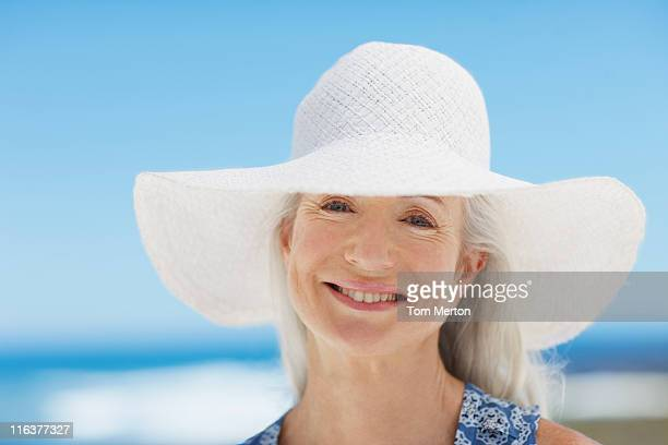 close up of woman wearing sun hat - sun hat stock pictures, royalty-free photos & images