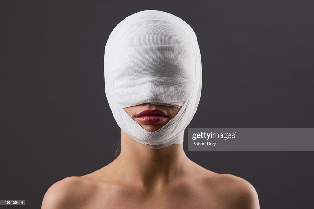 Close up of woman with bandaged face : Stock Photo