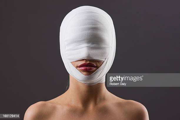 Close up of woman with bandaged face