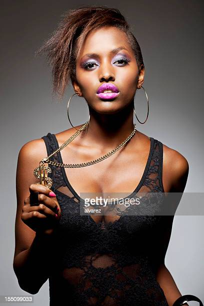 close up of woman with dollar symbol - all hip hop models stock photos and pictures