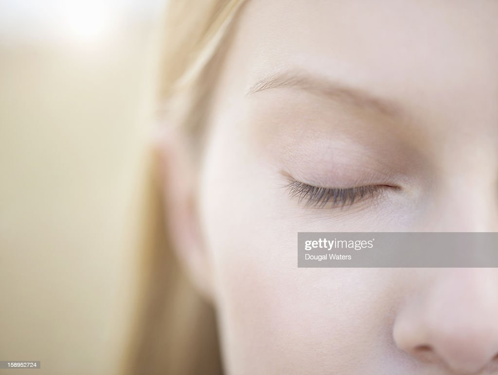 Close up of woman with eye closed. : Stock Photo