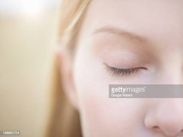 close up of woman with eye closed. - eyes closed stock pictures, royalty-free photos & images