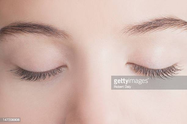 close up of woman with eyes closed - eyes closed stock pictures, royalty-free photos & images