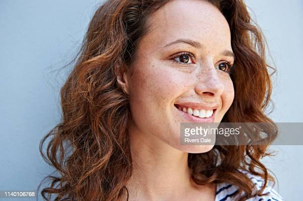 close up of woman with freckles - wavy hair stock pictures, royalty-free photos & images