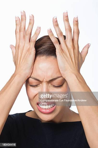 "close up of woman with hands on head - ""compassionate eye"" fotografías e imágenes de stock"