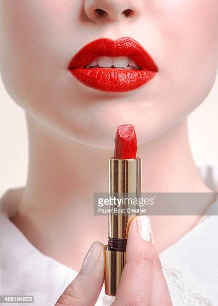 Close up of woman with lipstick and red lips