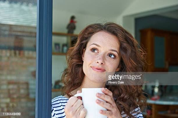 close up of woman with mug - wavy hair stock pictures, royalty-free photos & images