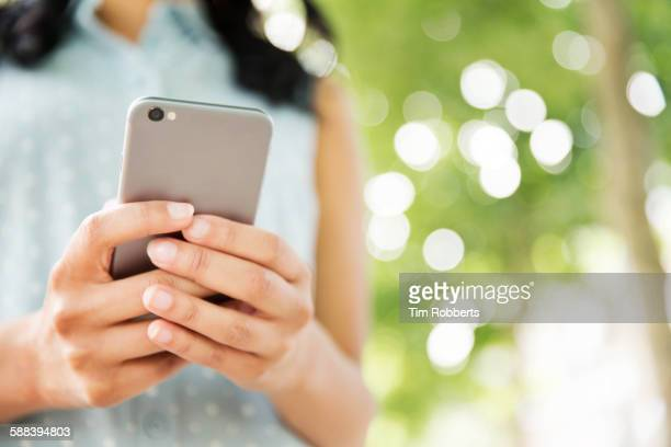 Close up of woman with smart phone.