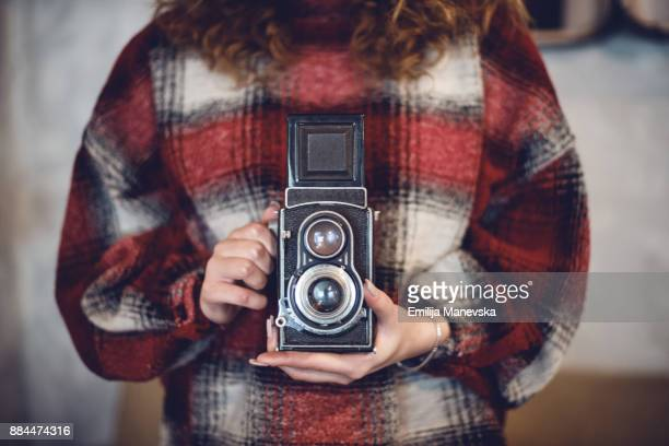 Close up of woman with vintage camera