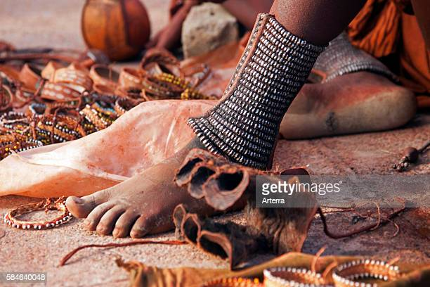 Close up of woman's feet decorated with anklets and jewellery of the Himba tribe, Namibia, South Africa.